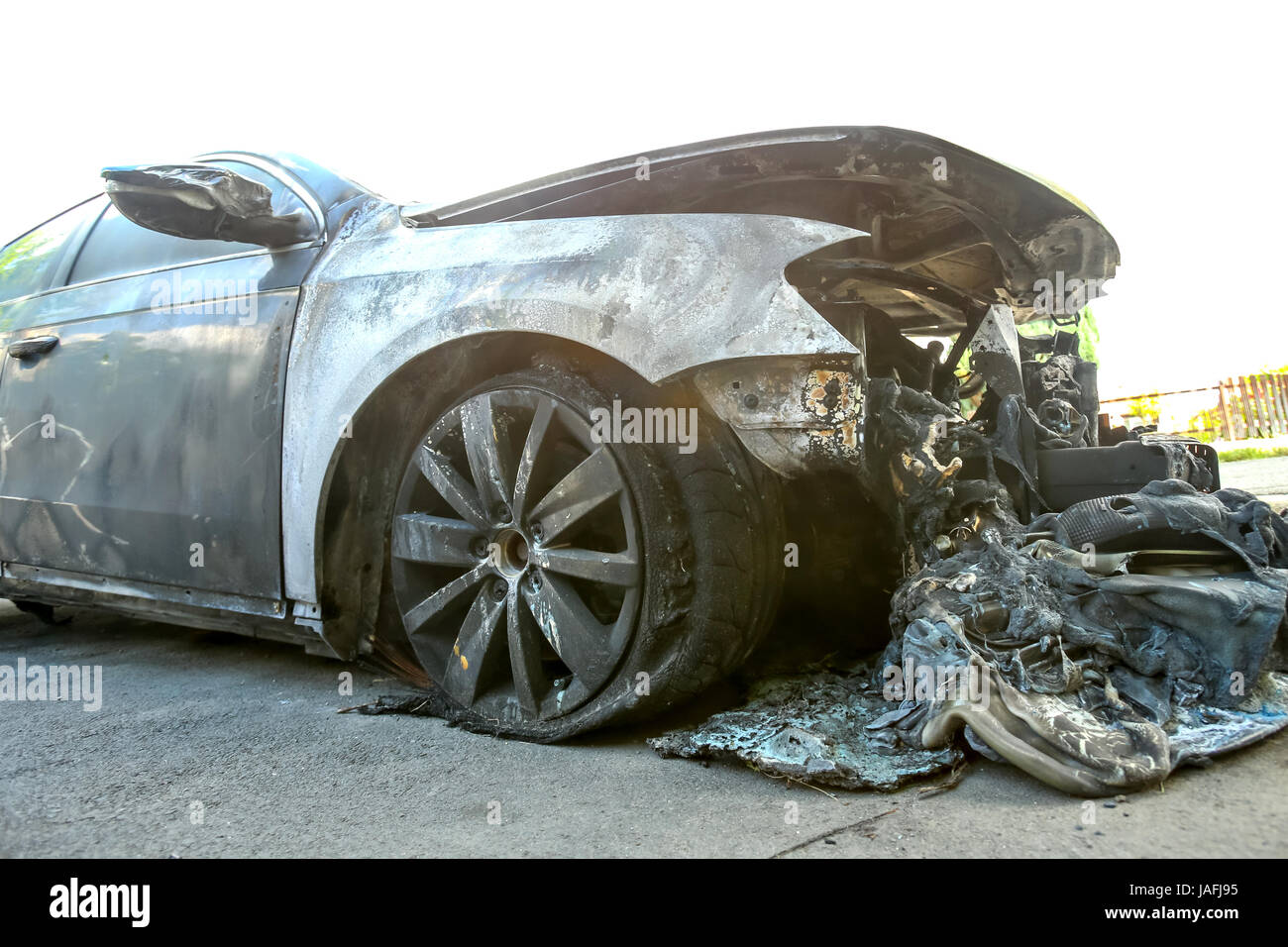 The exterior of a burned out car. - Stock Image