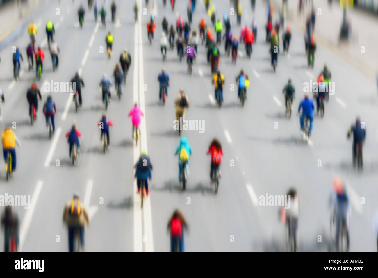 Abstract blurred background of Large group of bicyclists on street of city. Participants are unrecognizable. Sport, - Stock Image