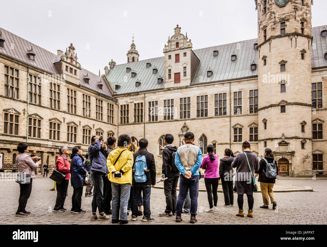Asian tourists giuded at Kronborg castle  Elsinore, Denmark, May 30, 2017 - Stock Image