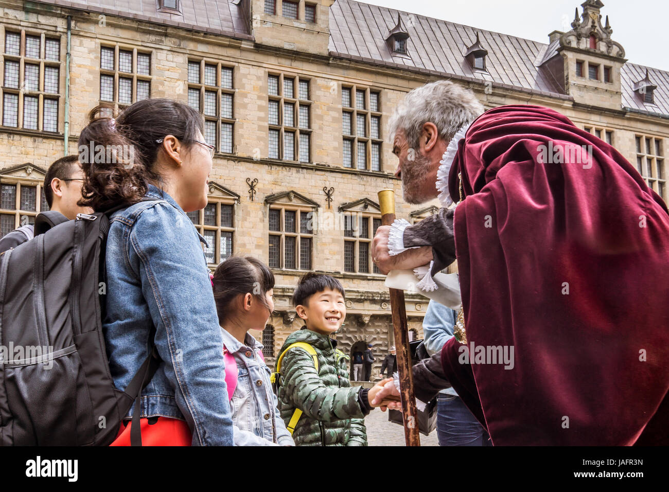 Asian family at Kronborg castle talking to an actor, Elsinore, Denmark, May 30, 2017 - Stock Image