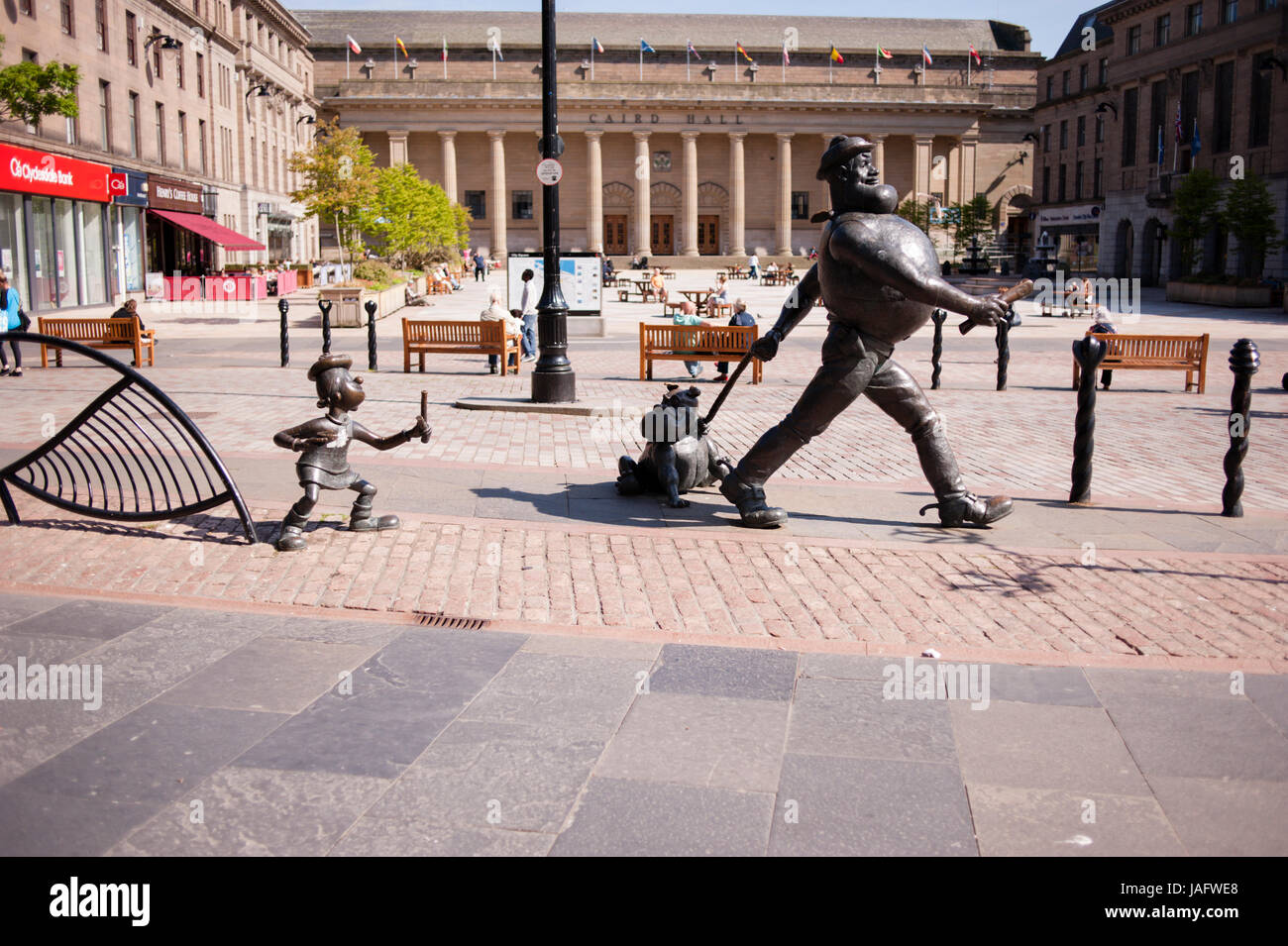 The statue of Desperate Dan in Dundee City Centre alongside a statue of Beano character, Minnie the Minx. Dundee, - Stock Image