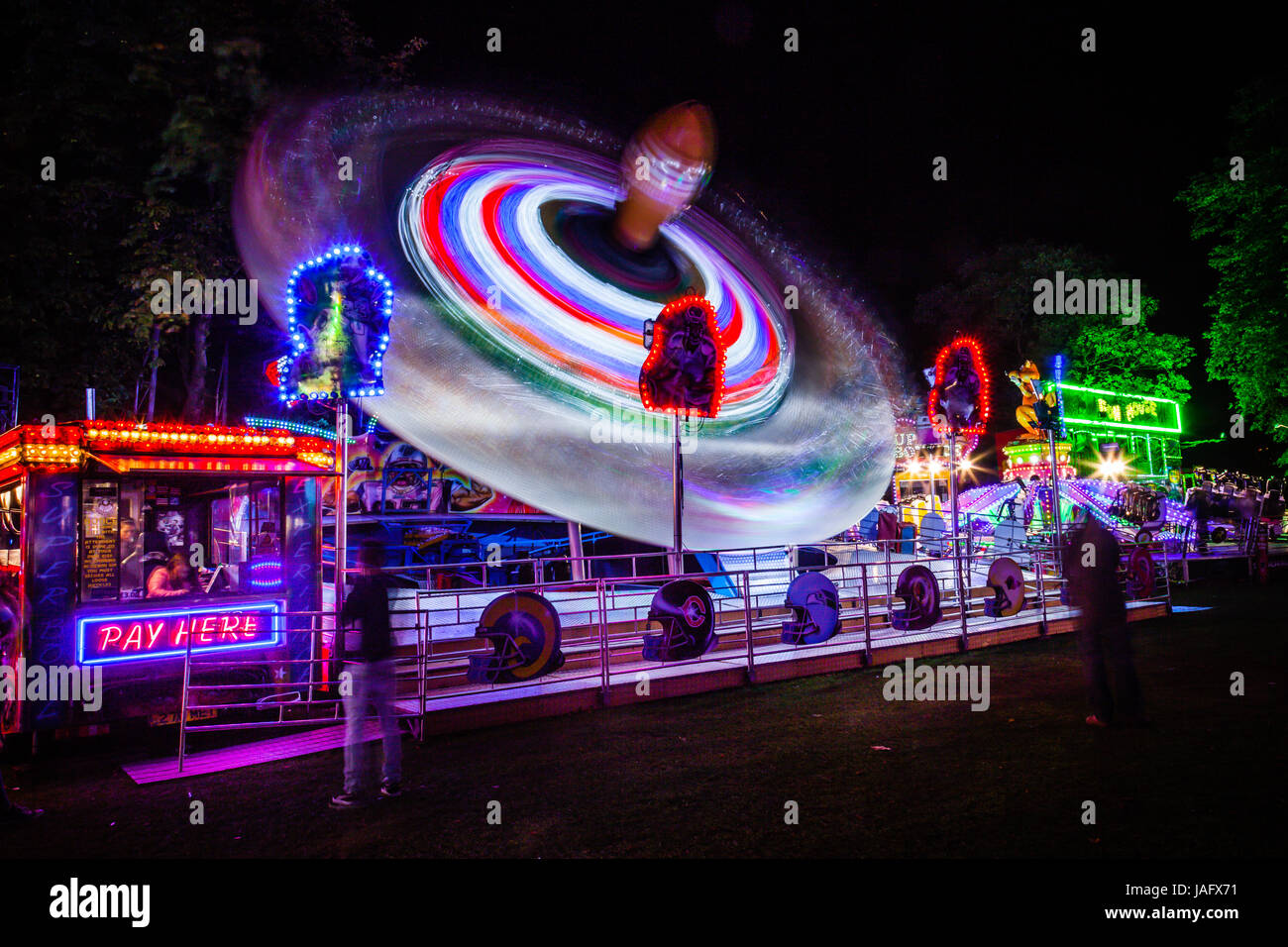 Light trace from 'The Superbowl' fairground ride at Witney Feast. - Stock Image
