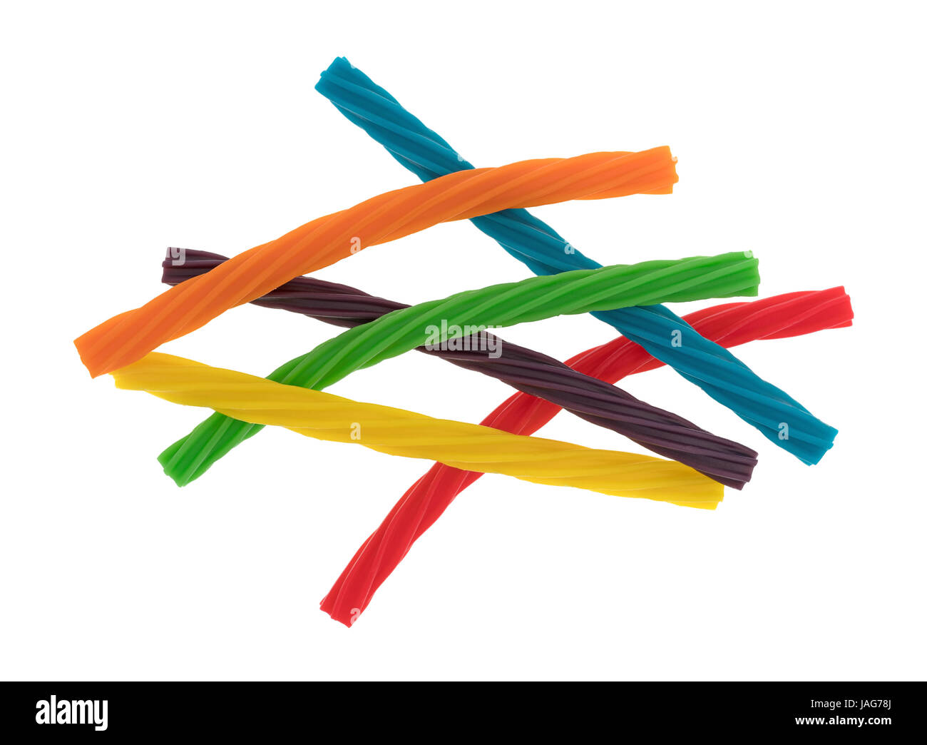 Top view of a group of colorful spiral licorice sticks isolated on a white background. - Stock Image