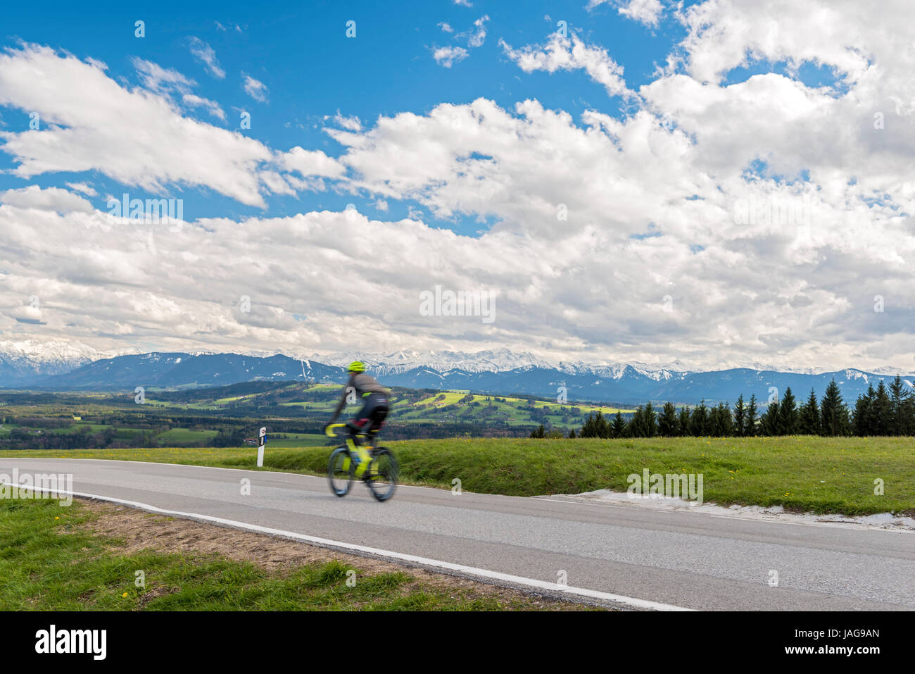 Bicycle Rider on Hohenpeißenberg, Upper Bavaria, Germany - Stock Image