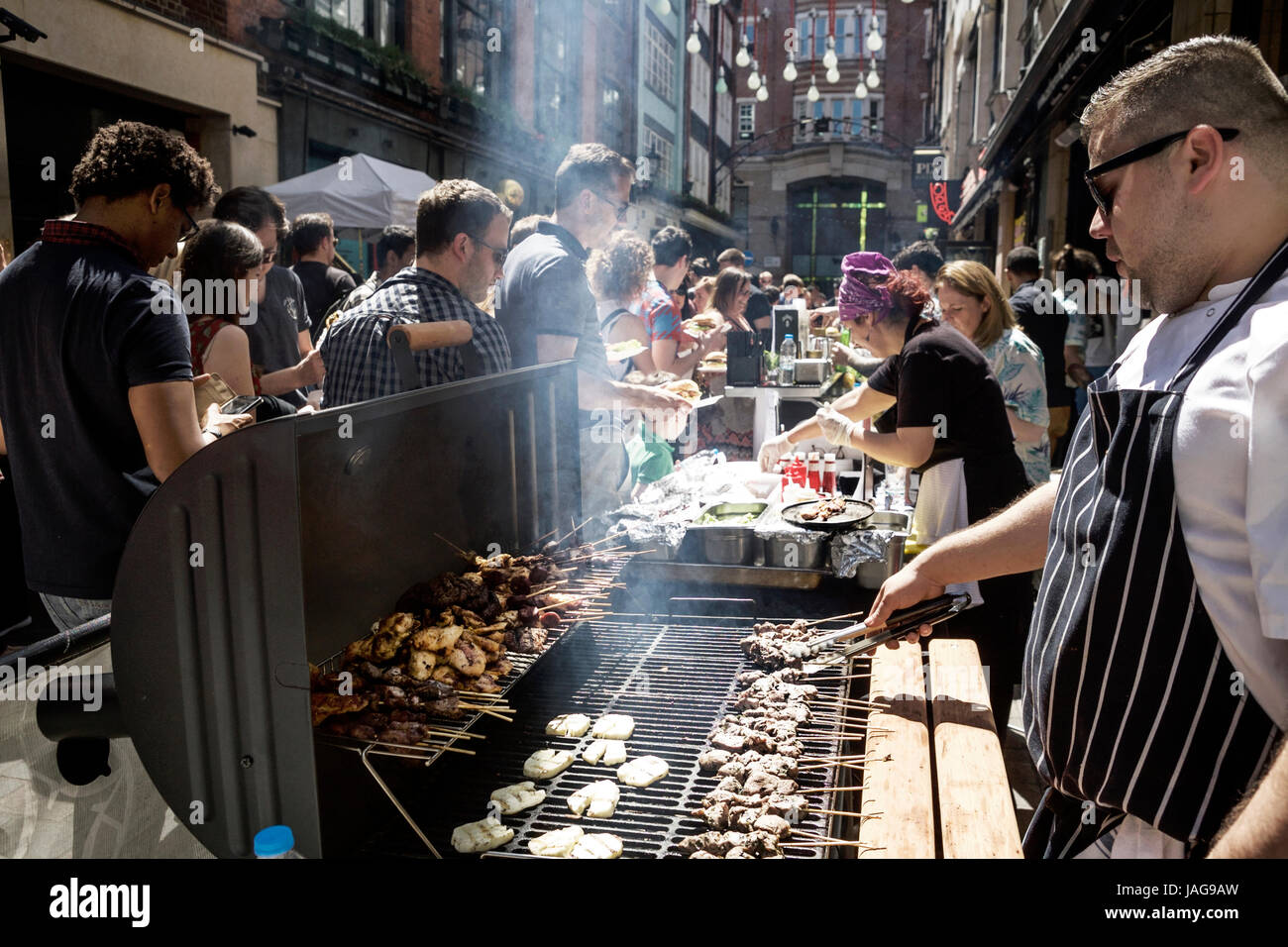 """A street food festival in Carnaby Street London: """"Carnaby Street Eat"""". London street food London. Street food UK - Stock Image"""
