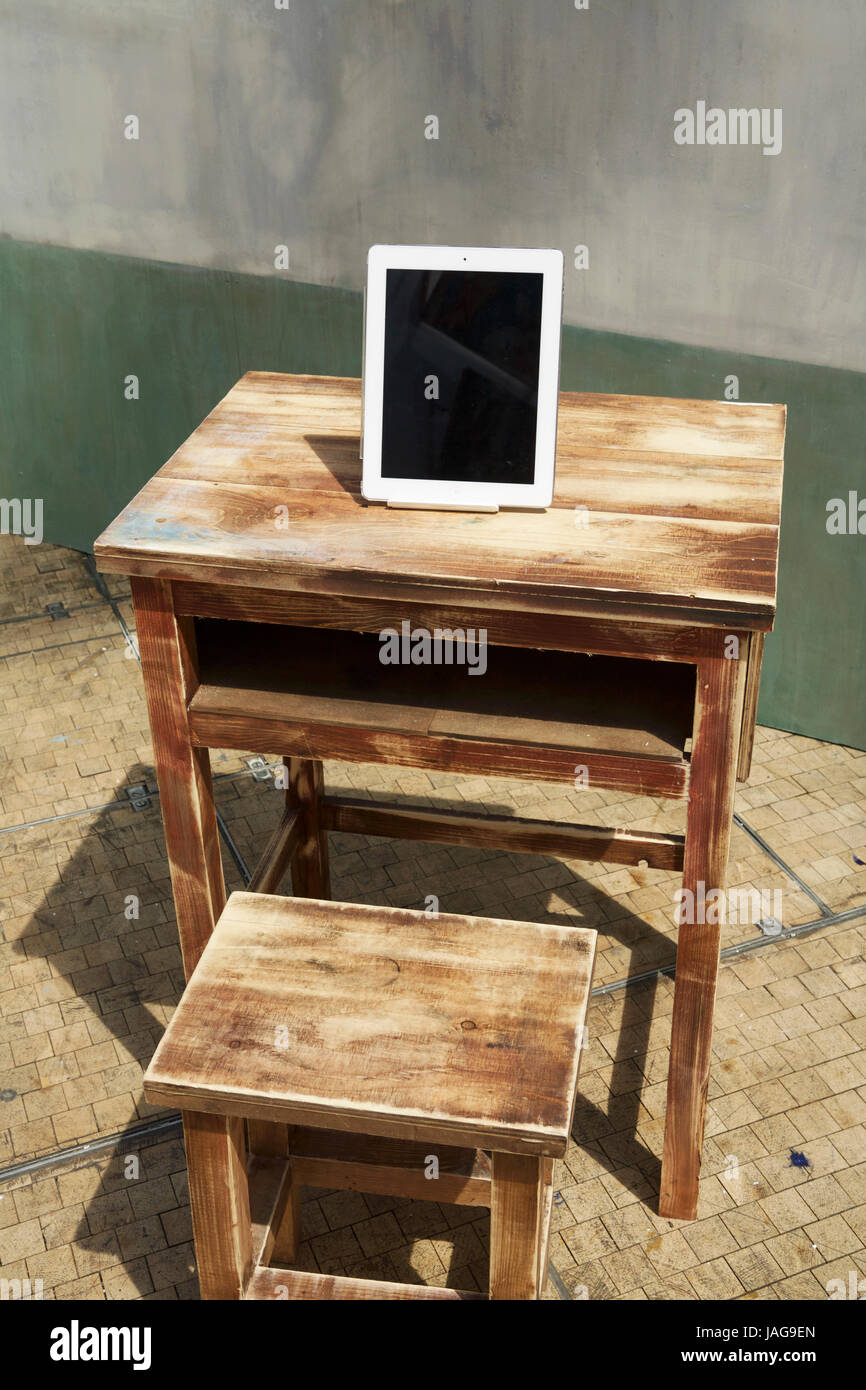 School desk, iPad, distance learning, internet wifi, third world education, access information, education concept, - Stock Image