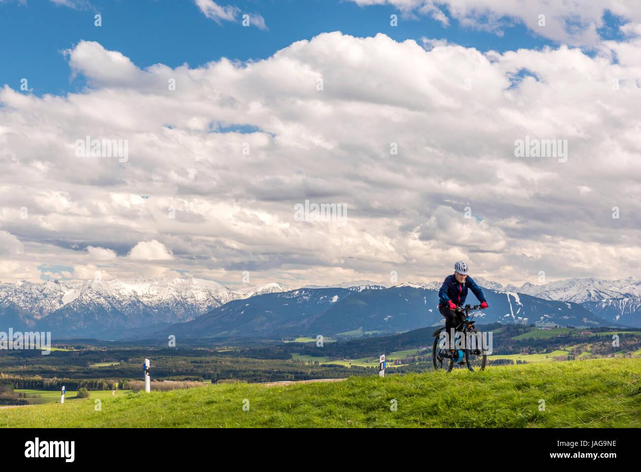 Bicycle Rider on Hohenpeißenberg, Upper Bavaria, Germany - Stock Image