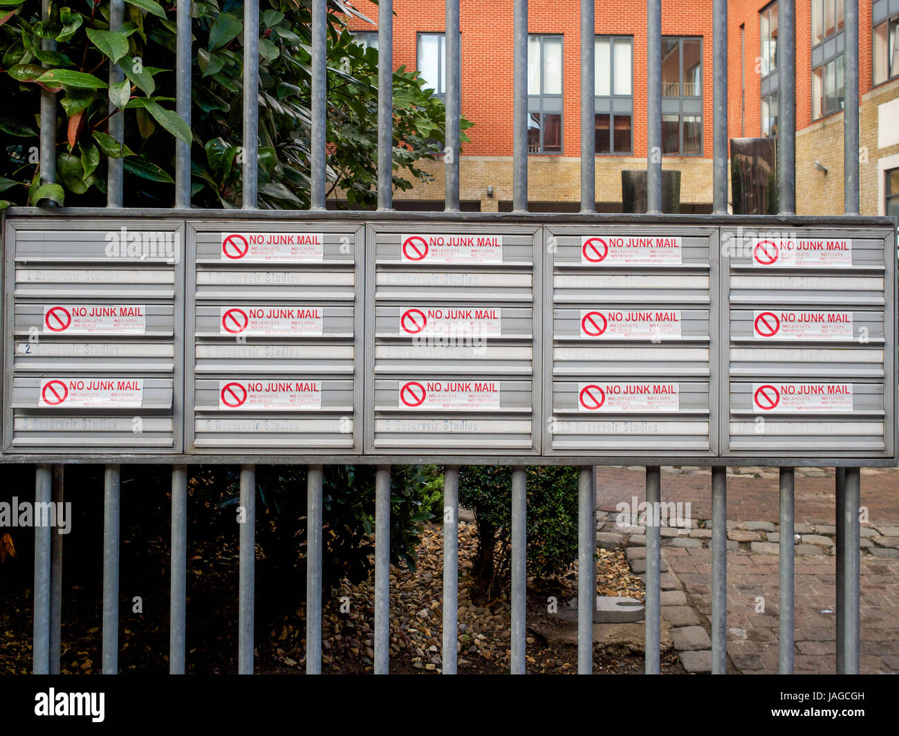 Letter boxes marked NO JUNK MAIL, near Cable Street, London, England. - Stock Image