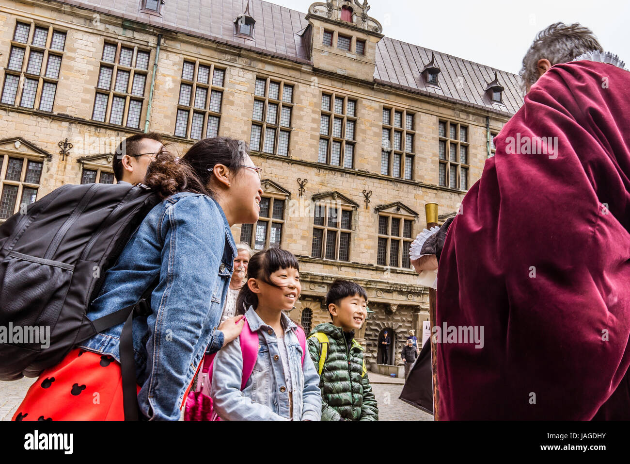 Asian family at Kronborg castle talking to an actor, Elsinore, Denmark, May 30, 2017 Stock Photo
