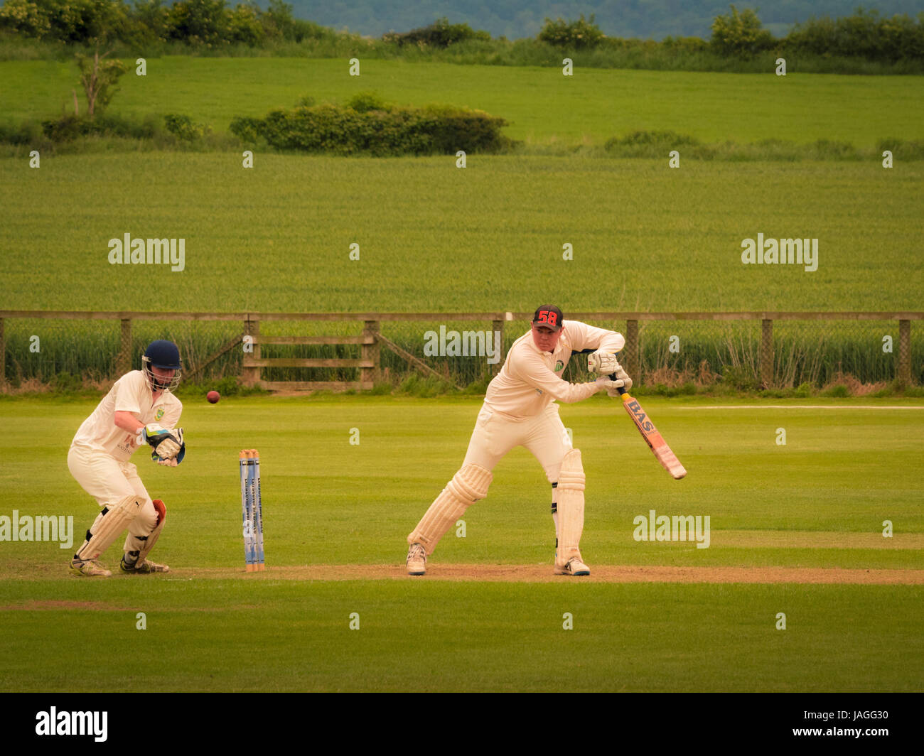 Game of Cricket being played in typical British village. - Stock Image