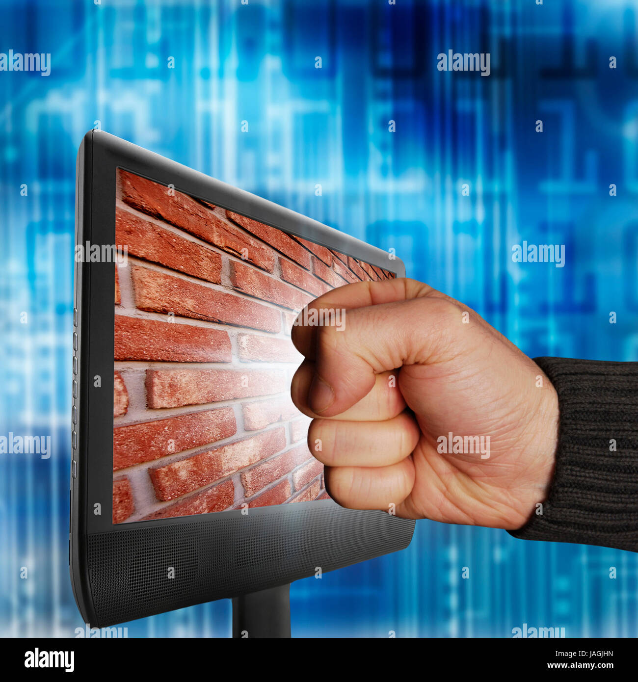 male fist trying to break a computer monitor and hitting a wall, firewall concept Stock Photo
