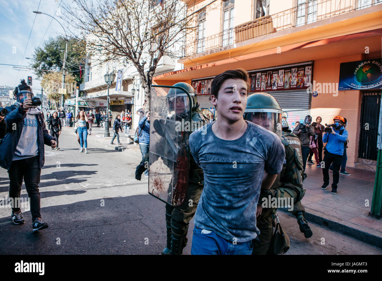 Valparaiso, Chile - June 01, 2017: Protester arrested by the chilean riot police during a protest in the center - Stock Image