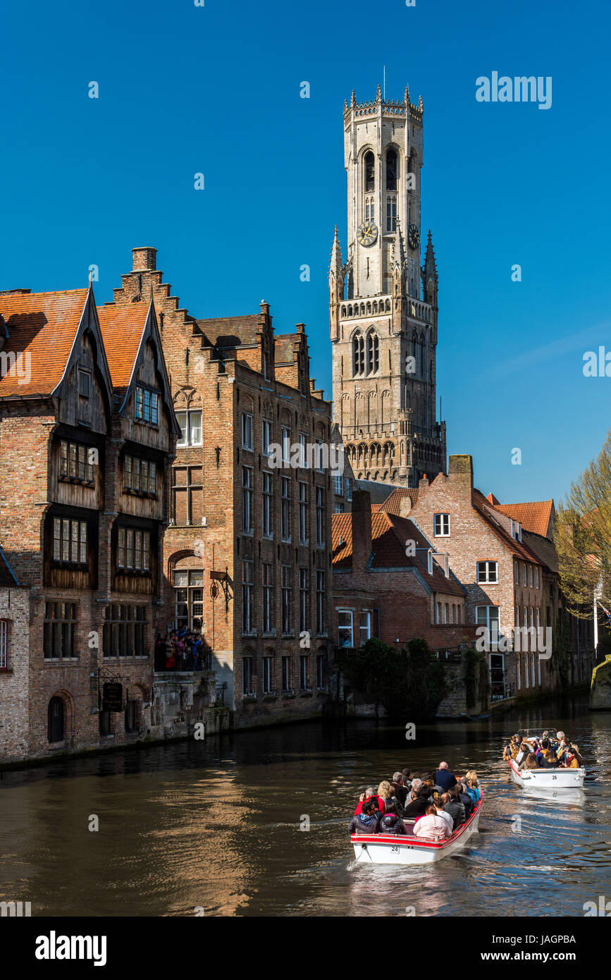 Dijver canal with Belfort tower in the background, Bruges, West Flanders, Belgium - Stock Image
