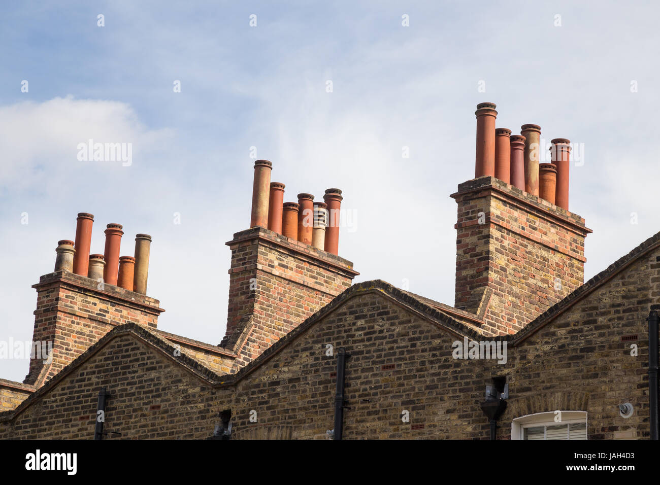 chimneypots on roofs of terraced houses in Islington, London N1, UK - Stock Image