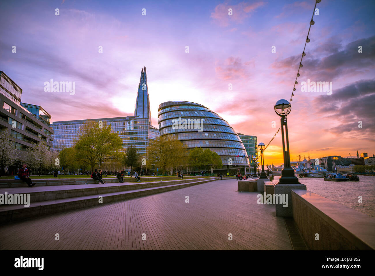Riverside promenade on the Thames, Potters Fields Park, Skyline, London City Hall, The Shard, at sunset, Southwark, - Stock Image