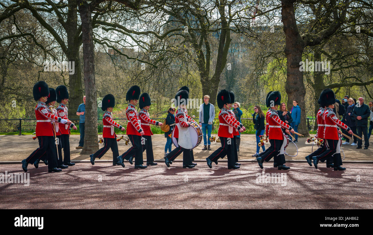 Guardsmen of the Queen's Guard, Royal Guards in red uniform on the way to Buckingham Palace, Changing of the - Stock Image