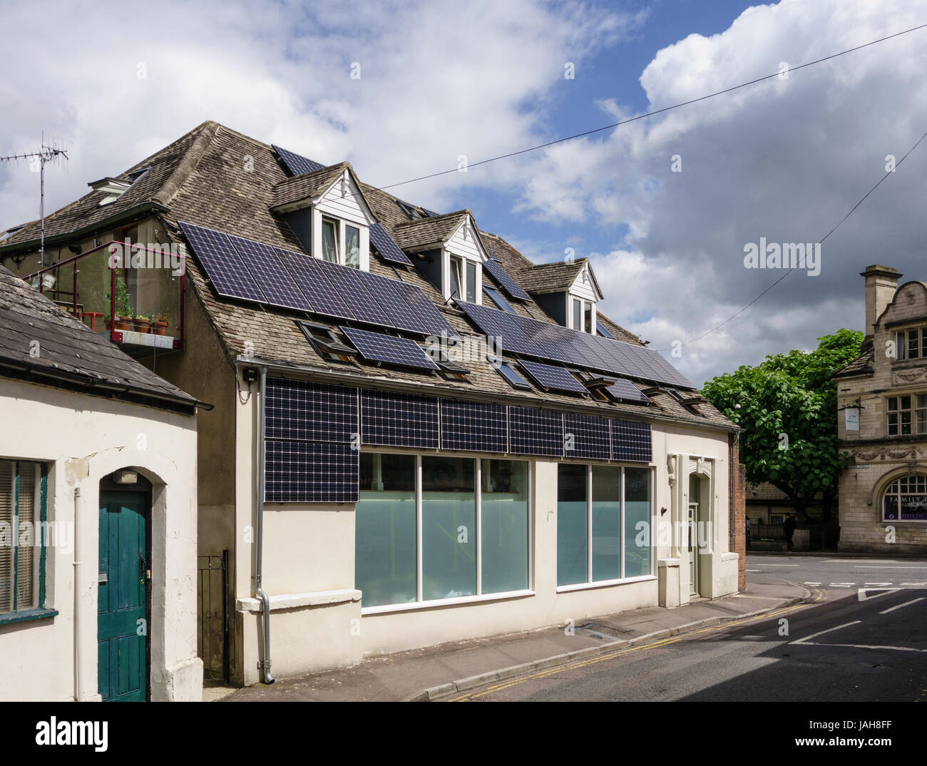Multiple solar panels installed on the roof of a building, Stroud, Gloucestershire, UK - Stock Image