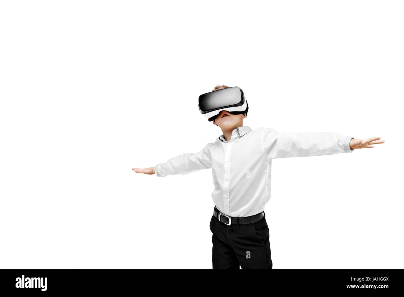 Excited boy being in virtual reality - Stock Image