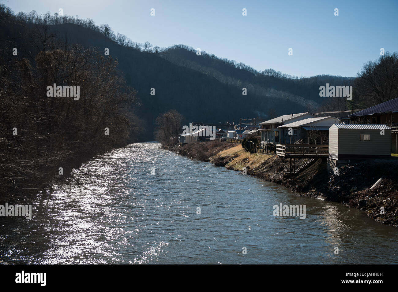 The morning sun rises over the Coal River in Whitesville, WV, home to base of operations for the WV Clean Water Stock Photo