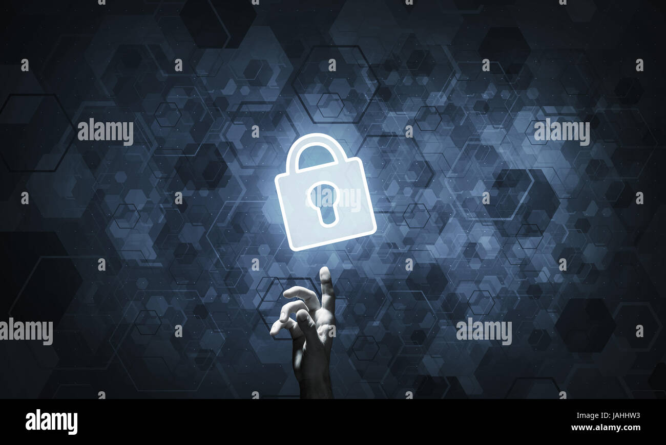 Hand pointing with finger at padlock as concept of internet secu - Stock Image