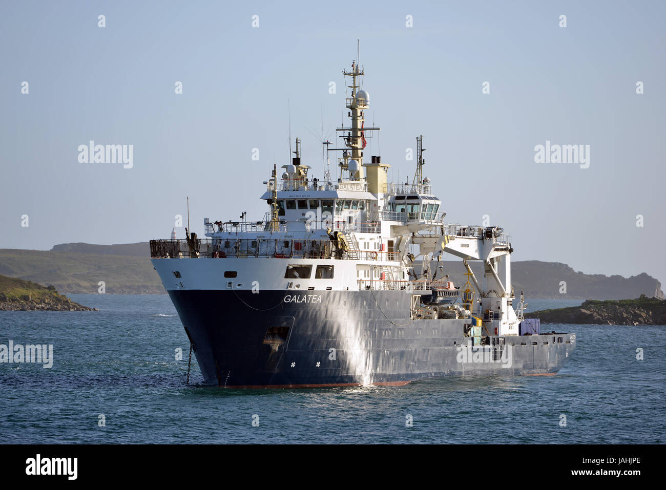 The Galatea, a buoy-laying vessel and lighthouse tender, in the Scilly Isles. - Stock Image