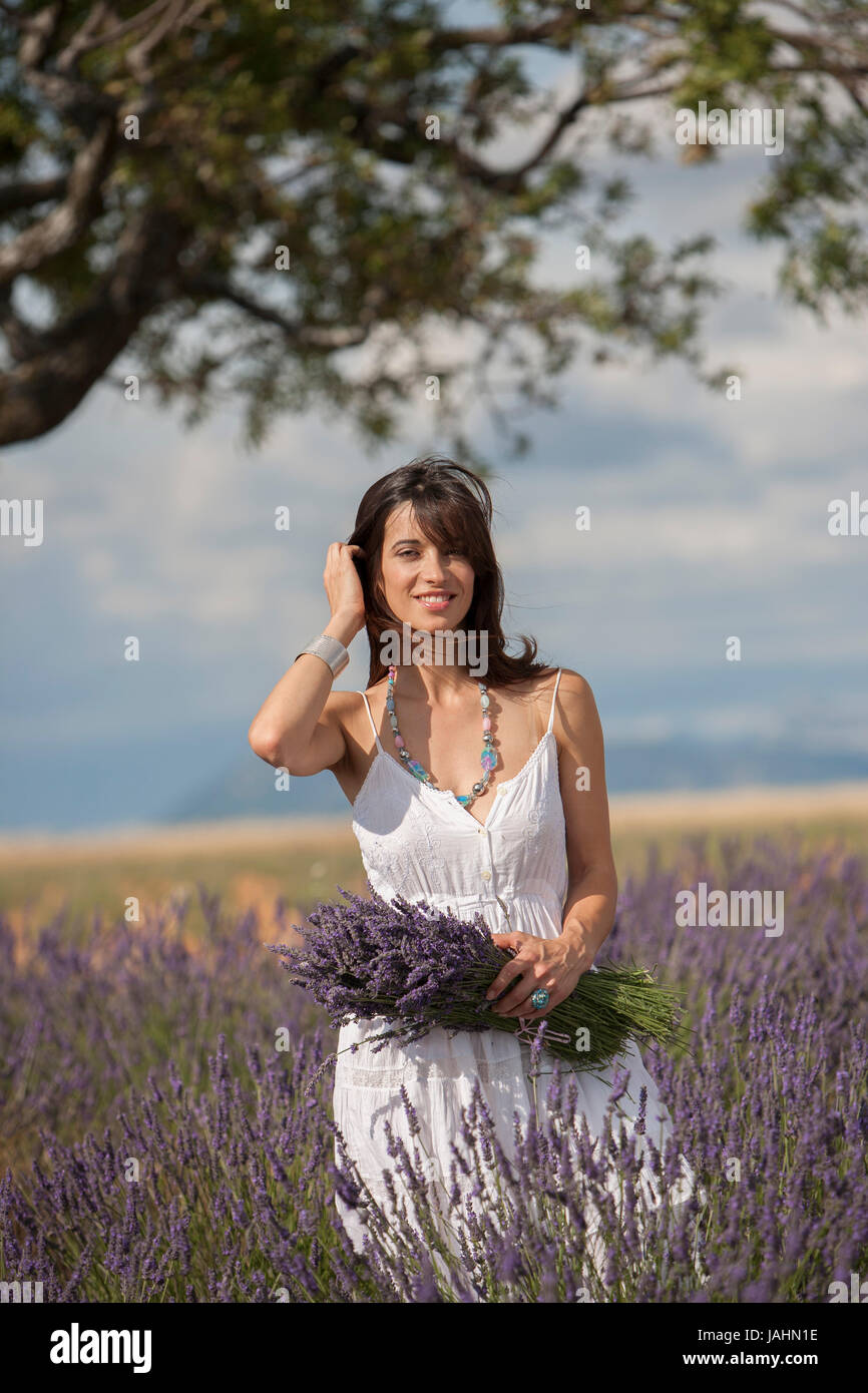 Young woman in a lavender field in Provence, South of France. Stock Photo
