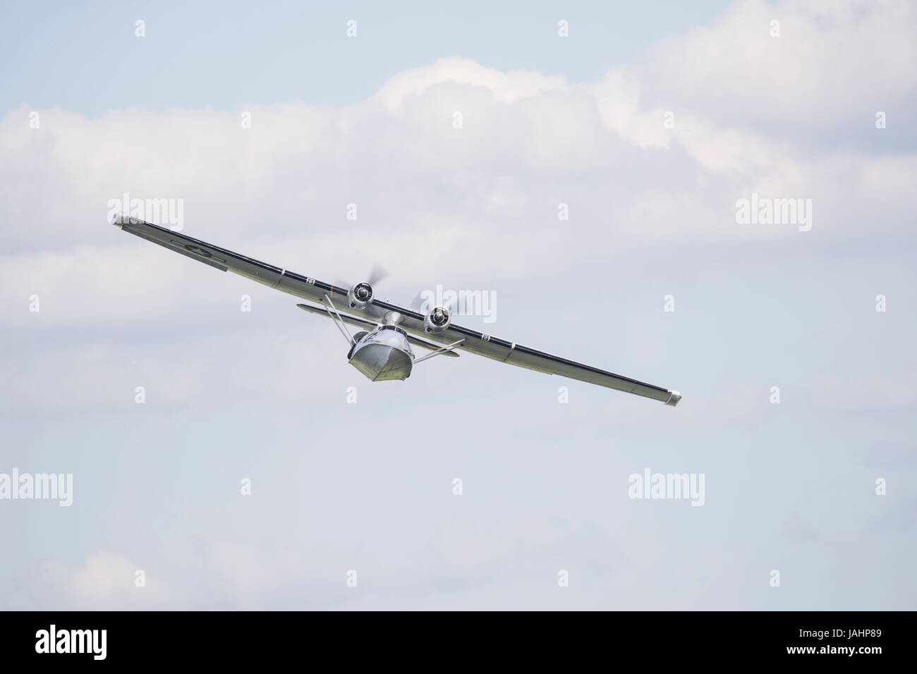Preserved PBY-5A Catalina flying boat  flying at a Duxford air show - Stock Image