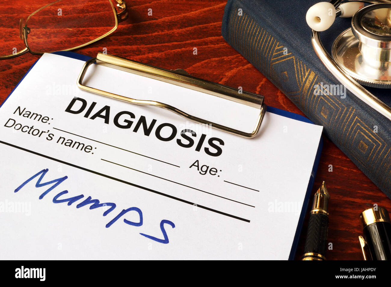Medical form with diagnosis Mumps on a table. - Stock Image
