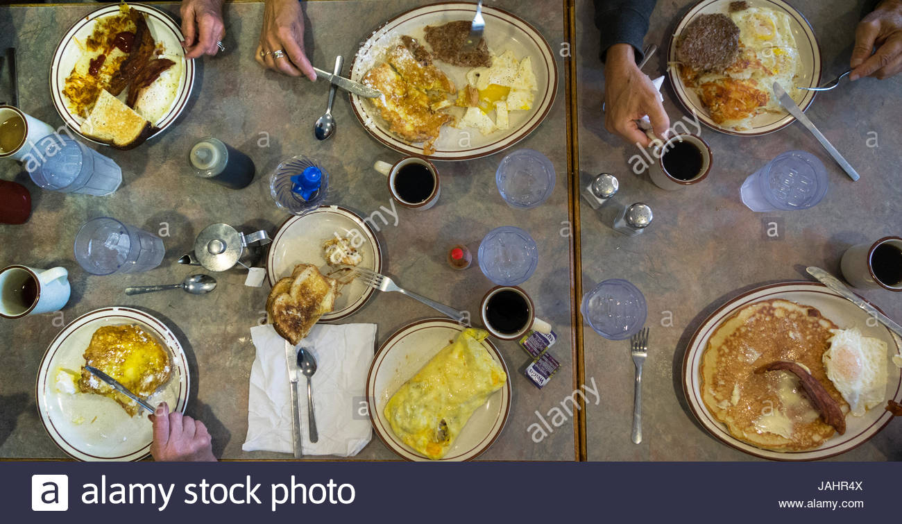 Diners enjoying a wide selection of huge breakfast entrees at the Family Diner restaurant. - Stock Image