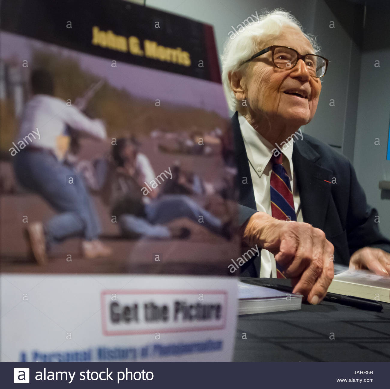 Legendary picture editor John G. Morris, 97, signing copies of his book 'Get the Picture.' - Stock Image
