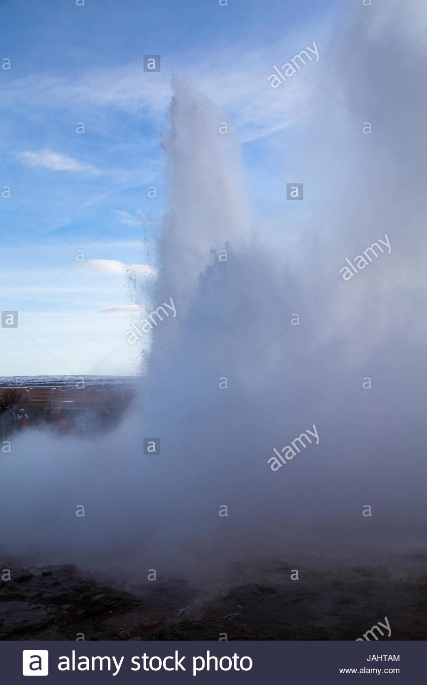 Strokkur geyser, a fountain geyser in the Haukadalur valley, erupting. Stock Photo