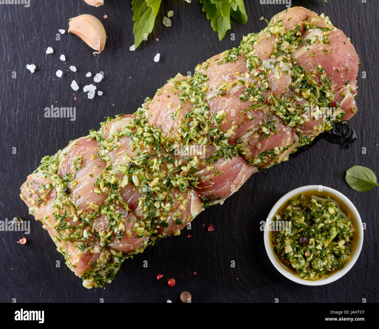 Raw pork loin with spices ready for baking Stock Photo