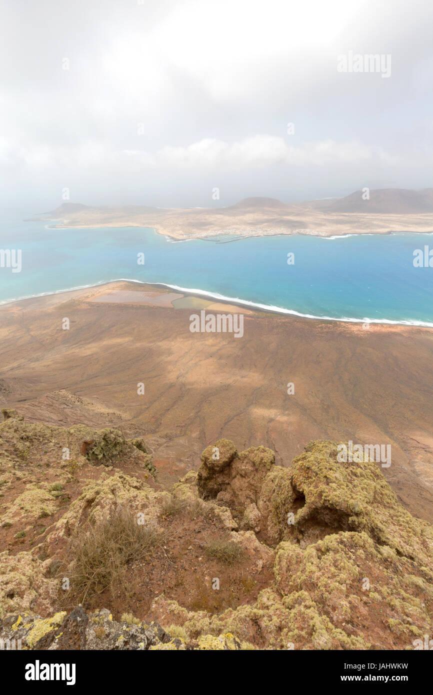 Mirador del Rio Lanzarote - a viewpoint from the north coast of lanzarote towards the Island of La Graciosa; Lanzarote, - Stock Image