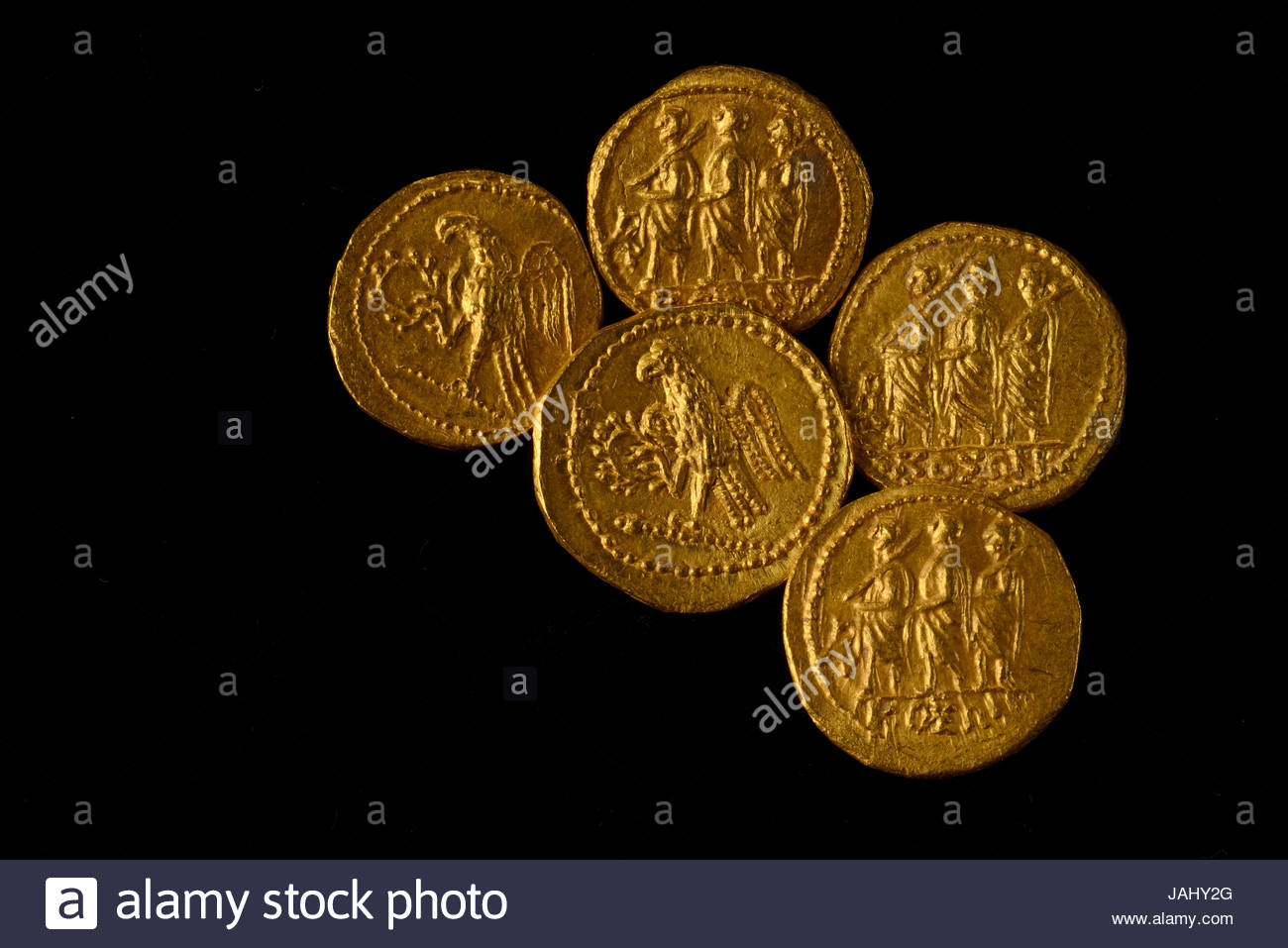 These gold coins with Roman imagery were looted from the ruins of Sarmizegetusa, the Dacian capital, and recovered - Stock Image