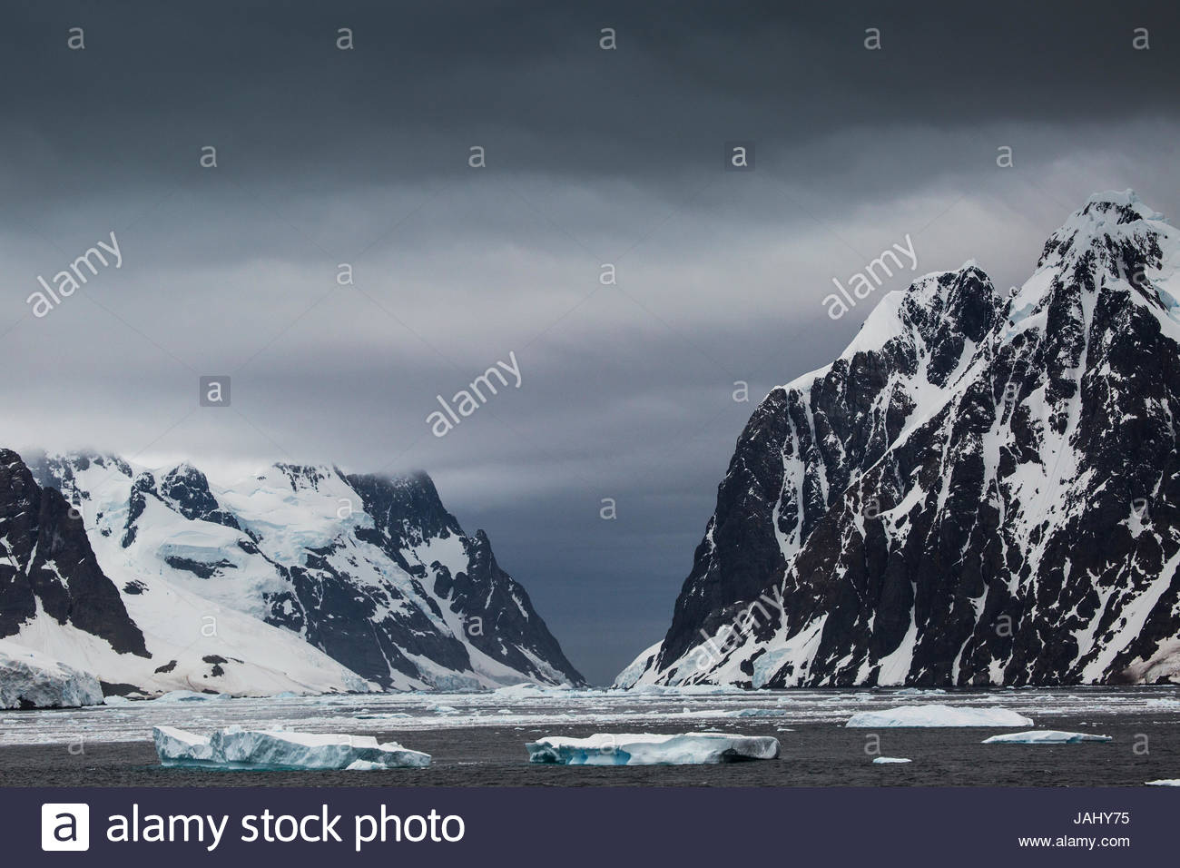 The southbound entry into Lemaire Channel, with the Antarctic mainland on the left. - Stock Image