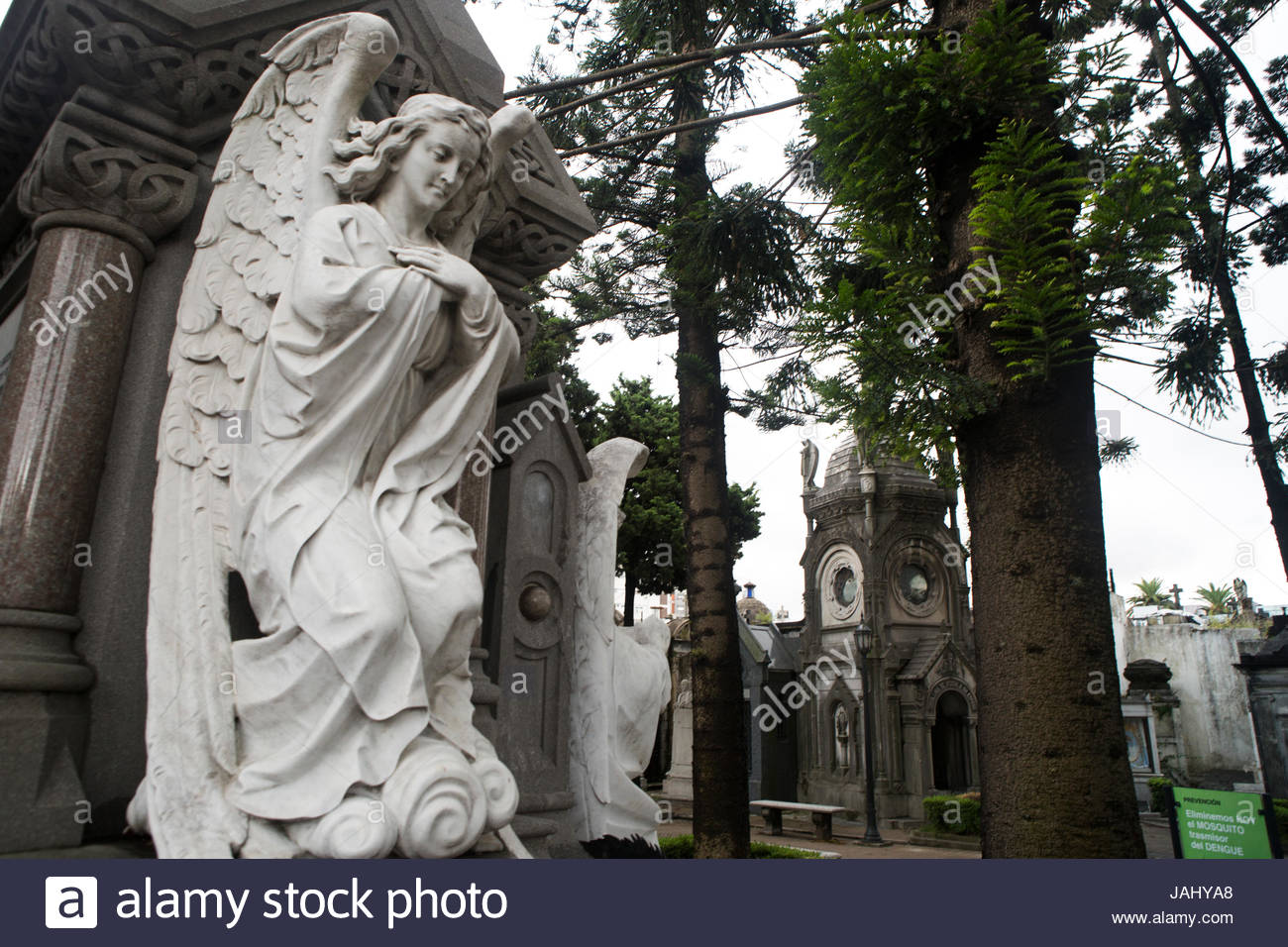 An angelic statue on the side of a tomb in the Recoleta Cemetery, in Buenos Aires, Argentina. - Stock Image