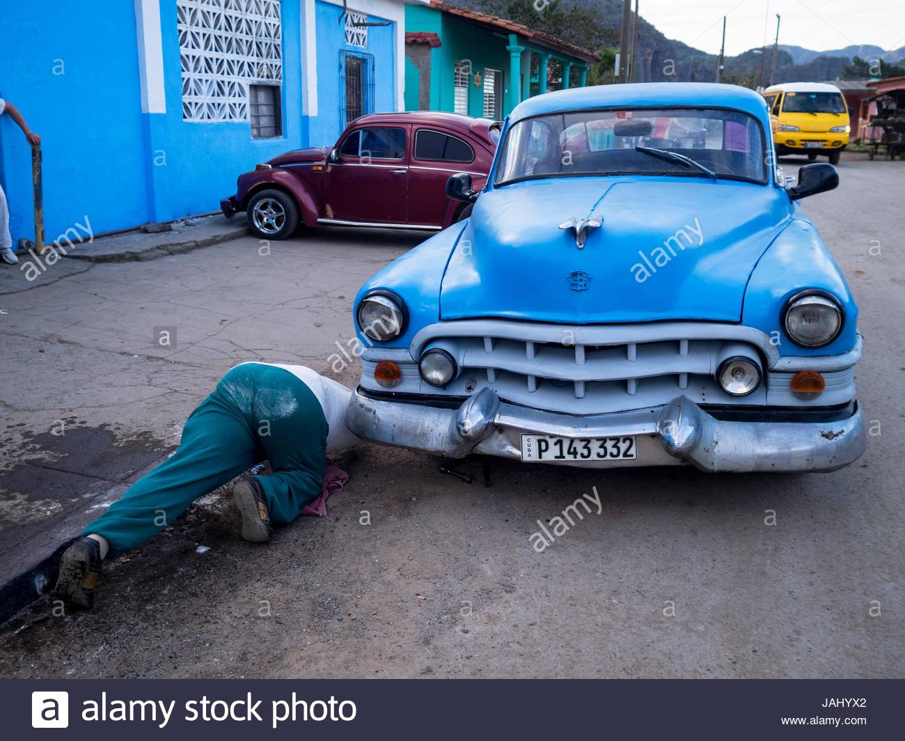 A vintage American car being repaired in Viales. - Stock Image