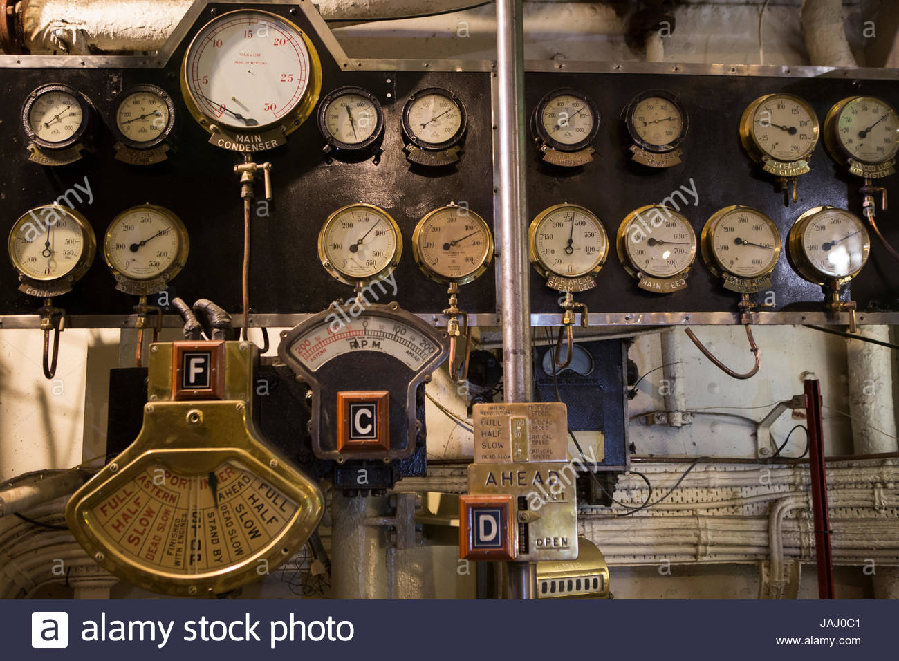 The control panel in the engine room on the RMS Queen Mary, on display in Long Beach. - Stock Image