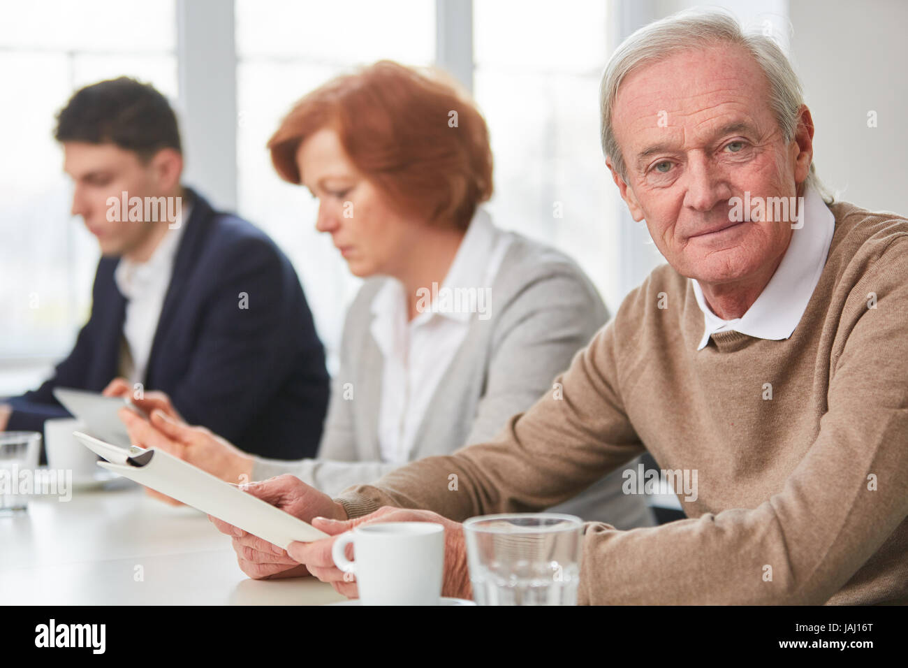 Senior man as businessman with experience and competence - Stock Image