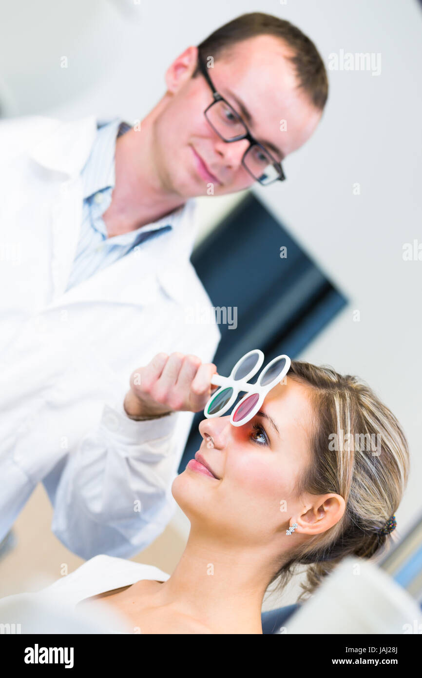 6c0c42d8cd7 Optometry concept - pretty young woman having her eyes examined by an eye  doctor optometrist (color toned image  shallow DOF)