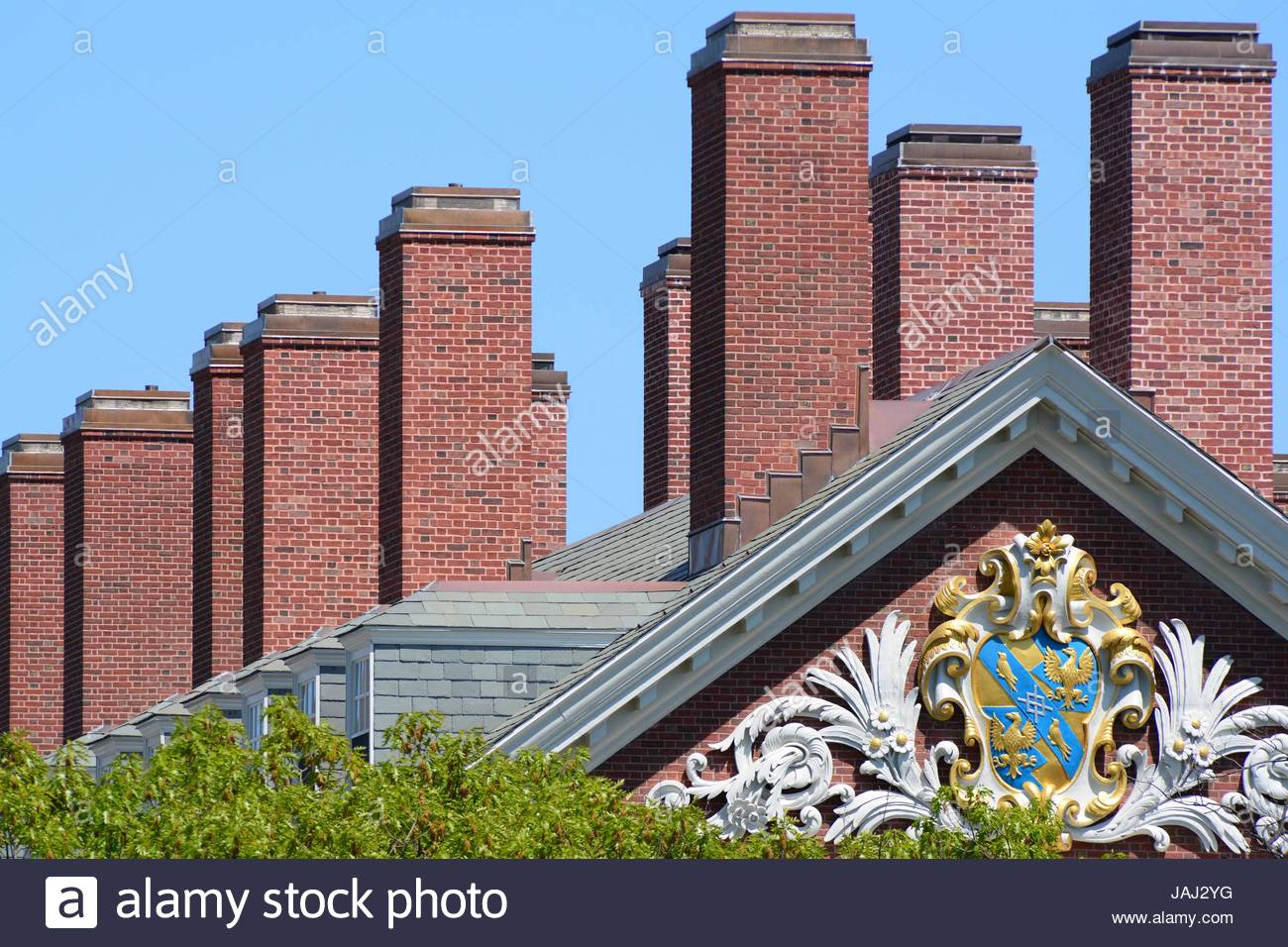 Roof and chimneys of Harvard University's Dunster House dormitory. - Stock Image