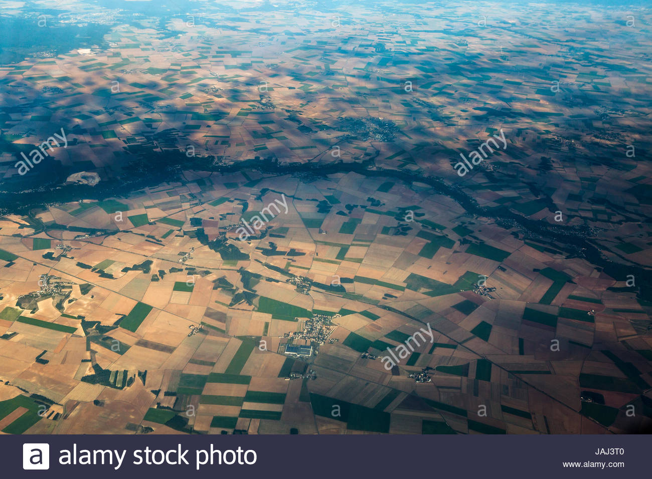 Fields and villages of rural France's Ile-de-France region. - Stock Image