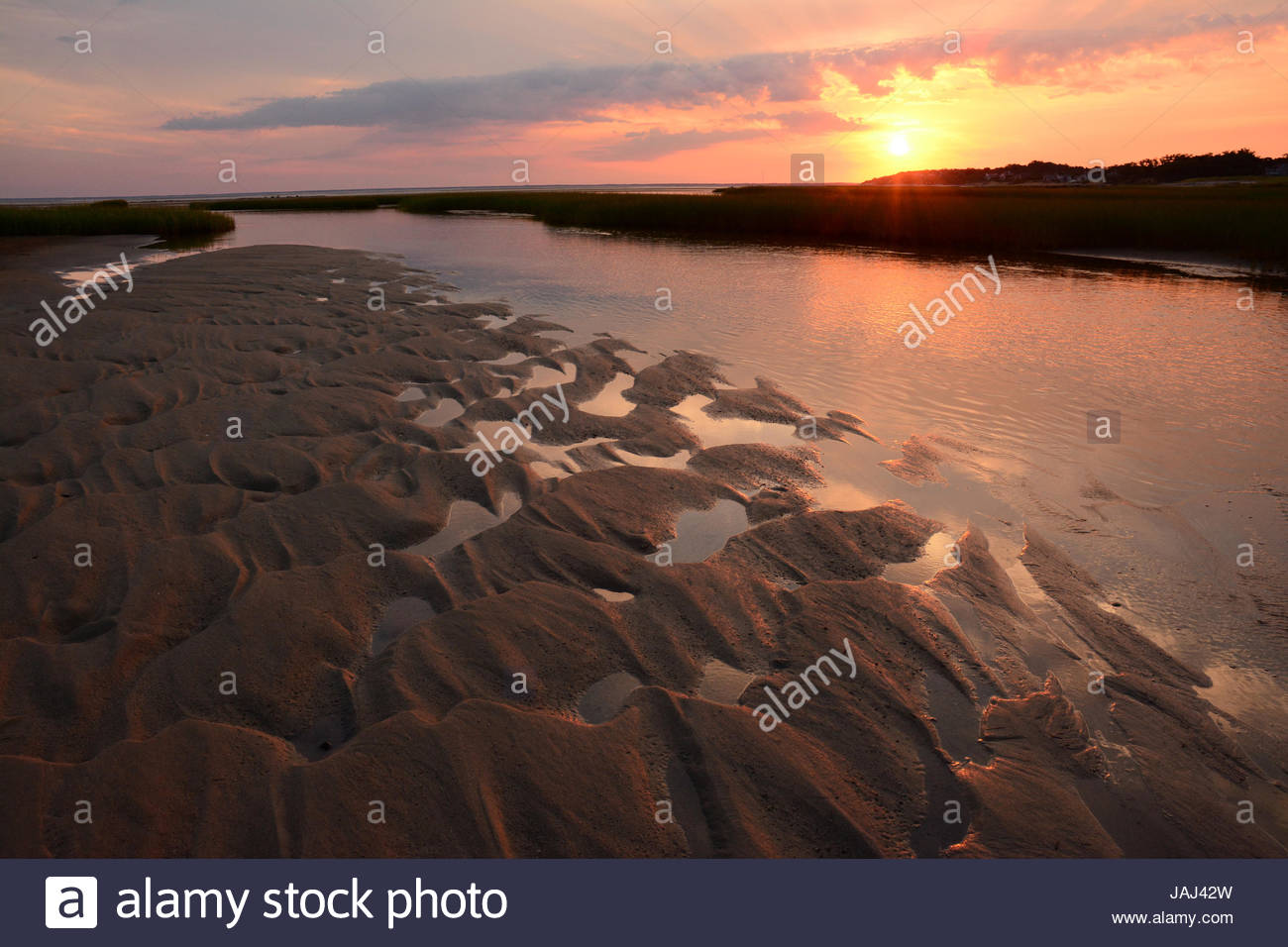 Sunrise over Payne's Creek estuary and tidal flats in Brewster, Cape Cod. - Stock Image