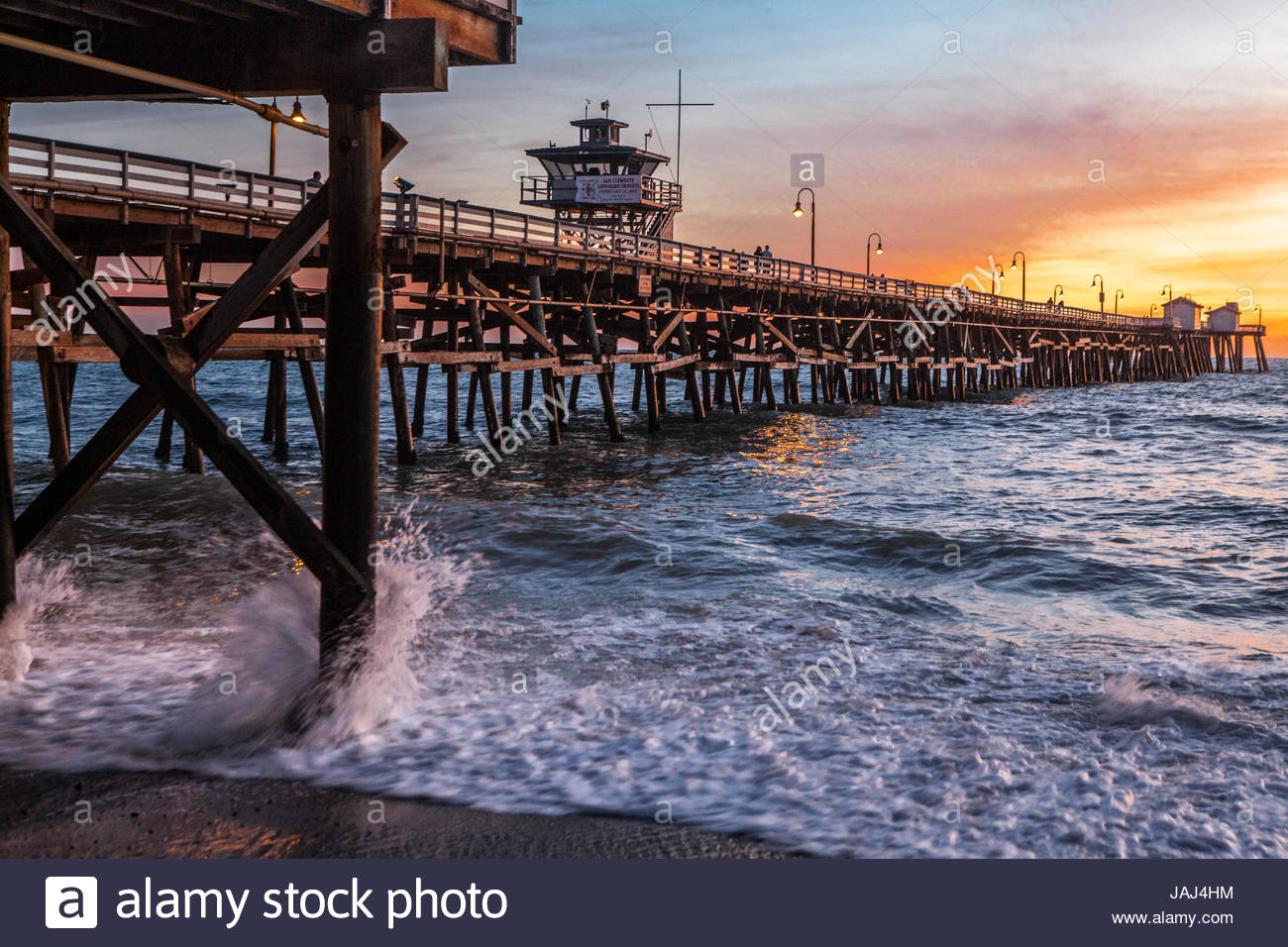 The 1,296 foot long wooden pleasure pier in San Clemente, California, at sunset. Stock Photo