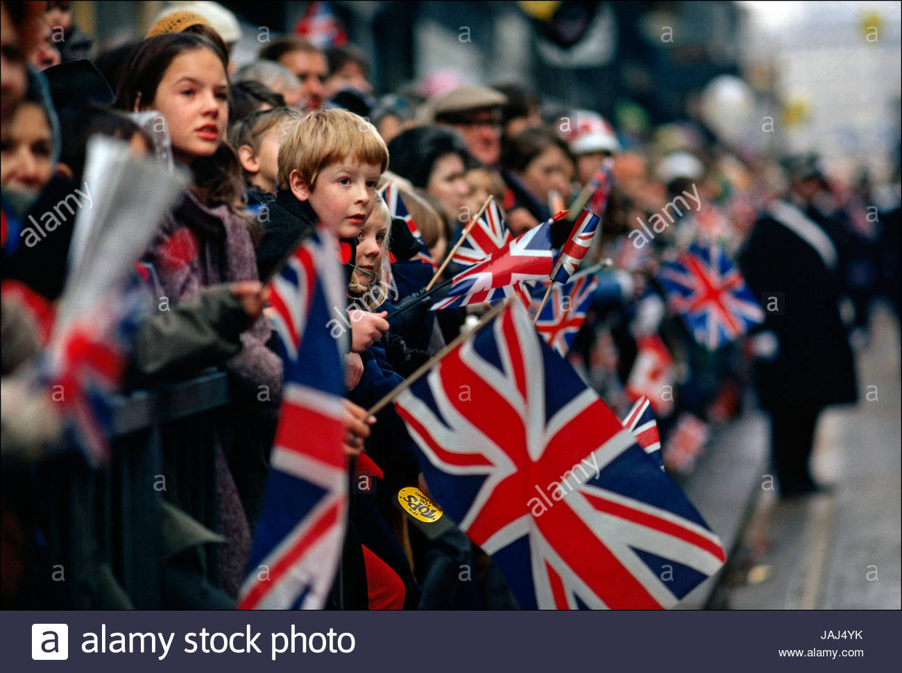 British Children Hold The National Flag Of The United Kingdom The