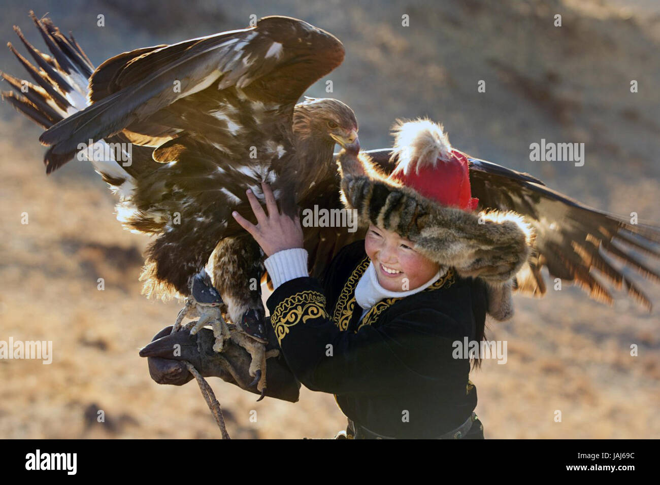The Eagle Huntress is a 2016 Kazakh-language British-Mongolian-American documentary film directed by Otto Bell and - Stock Image