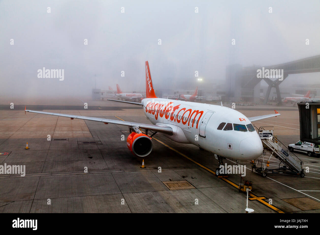 A Easy Jet Plane On The Ground In The Fog At London Gatwick Airport, West Sussex, UK - Stock Image