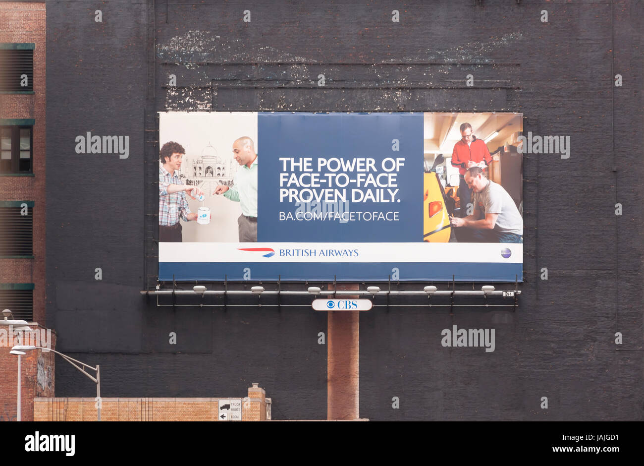 A billboard touting the power of face-to-face communication and interaction. - Stock Image
