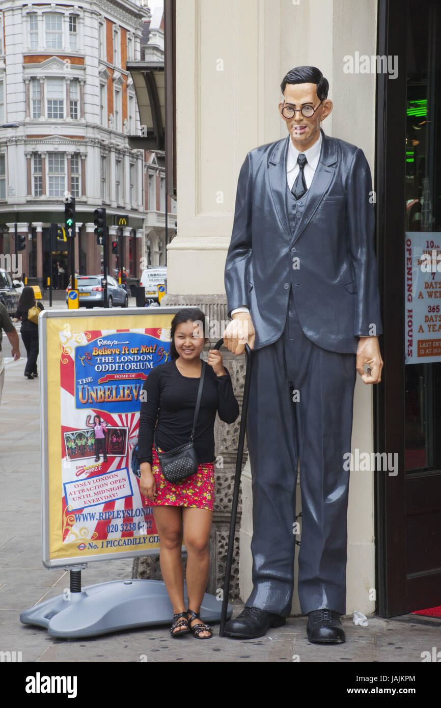 England,London,Picadilly Circus,tourist and oversized character before 'Ripley's Believe it or not!' - Stock Image