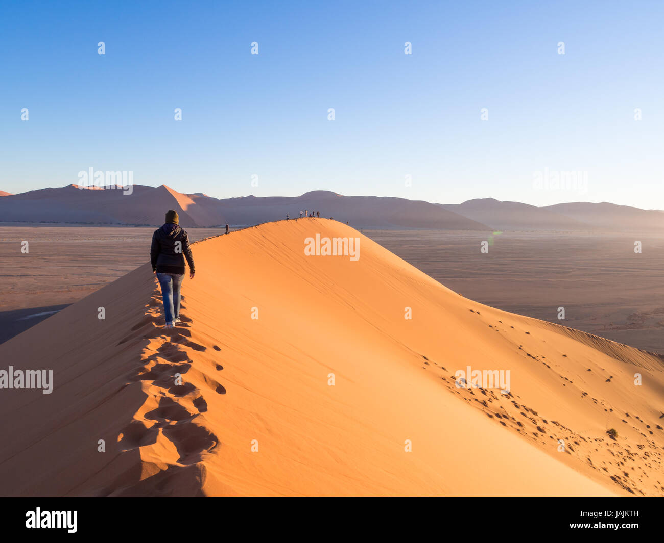SOUSSUSVLEI, NAMIBIA - JUNE 20, 2016: People watching sunrise form the Dune 45 in the Sossusvlei area of the Namib Stock Photo